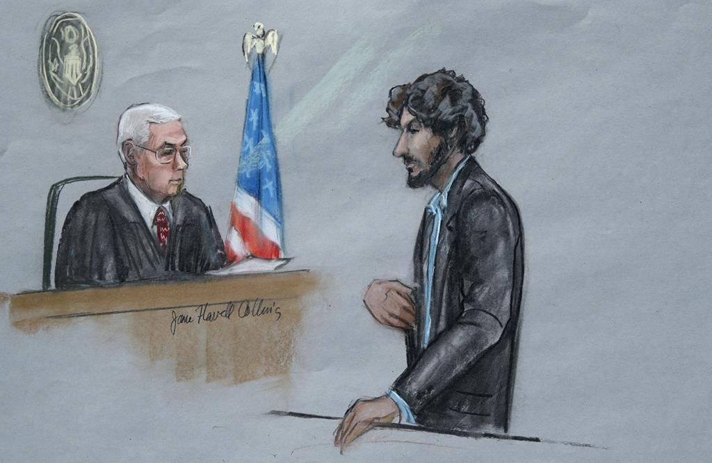 In this courtroom sketch, Boston Marathon bomber Dzhokhar Tsarnaev (R) stands before U.S. District Judge George O'Toole Jr. as he addresses the court during his sentencing, Wednesday, in federal court in Boston.  (Jane Flavell Collins via AP)