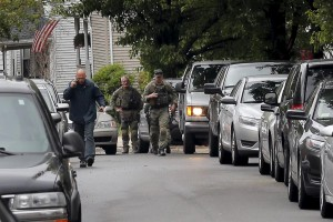 Law enforcement officials are gathered on a residential street in Everett, Massachusetts, in connection to a man shot dead by law enforcement in Boston after coming at them with a large knife when they tried to question him as part of a terrorism-related investigation, authorities said.  (REUTERS/Brian Snyder)
