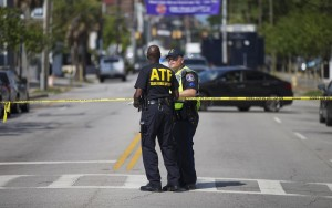 Officers stand down the street from the Charleston, S.C. church where the shooting too place, Thursday. (AP Photo/David Goldman)
