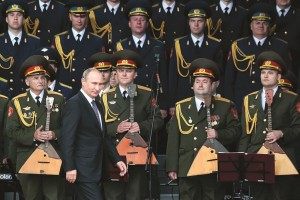 Russian President Vladimir Putin, foreground, leaves a podium after delivering his speech at the opening of the Army-2015 international military show features the latest Russian weapons in Kubinka, outside Moscow, Russia, Tuesday. (AP Photo/Ivan Sekretarev)