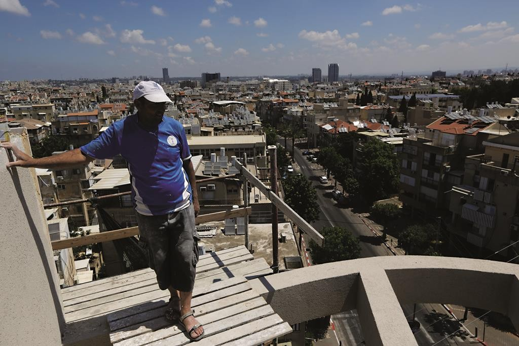 A worker seen at the site of newly constructed buildings in the ultra orthodox Jewish city of Bnei Brak, central Israel. June 09, 2015. Photo by FLASH90