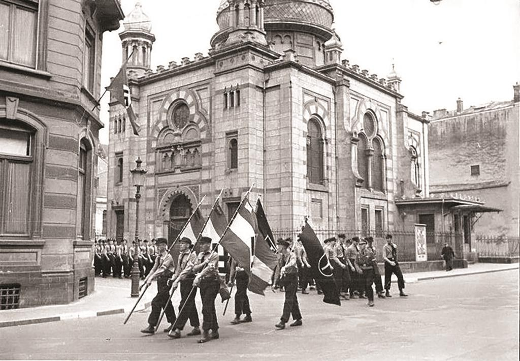 A Nazi parade in front of the Great Synagogue in Luxembourg in 1941. It was destroyed in 1943.