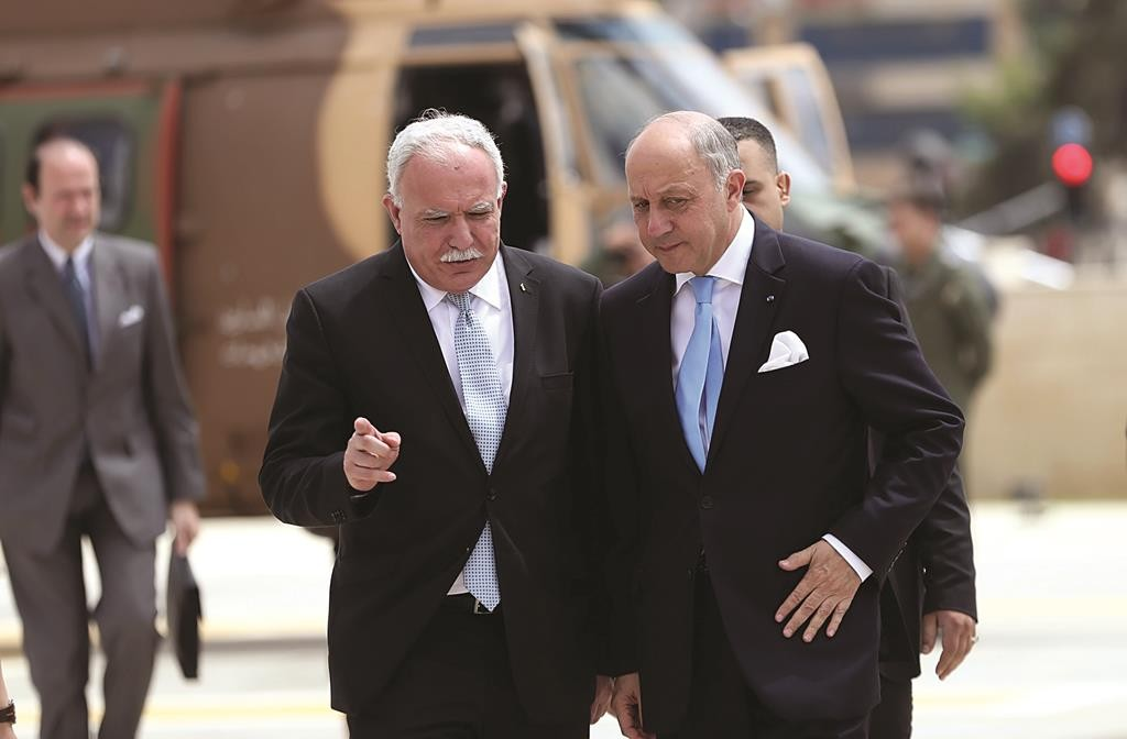 France's Foreign Minister Laurent Fabius (R) is welcomed by Palestinian Foreign Minister Riyad al-Maliki upon Fabius' arrival in Ramallah on Sunday. (REUTERS/Mohamad Torokman)