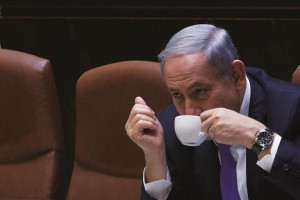 Israeli Prime Minister Binyamin Netanyahu seen drinking coffee during a Knesset session this week. (Miriam Alster /Flash90)