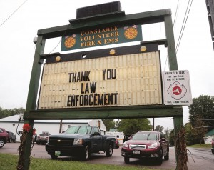 A sign at the Constable Volunteer Fire and EMS thanks law enforcement after the second of two escaped prisoners was apprehended. (AP Photo/Mike Groll)