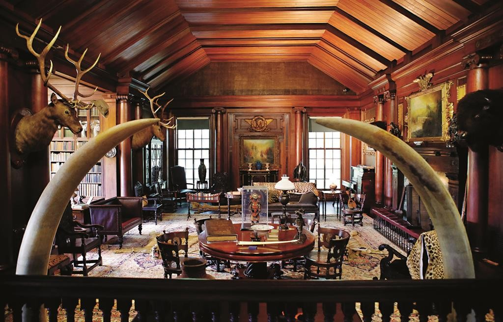 """Elk and bison heads along with mementos President Theodore Roosevelt received adorn the North Room, the 26th president's """"trophy room,"""" at Sagamore Hill last week. (AP Photo/Kathy Willens)"""