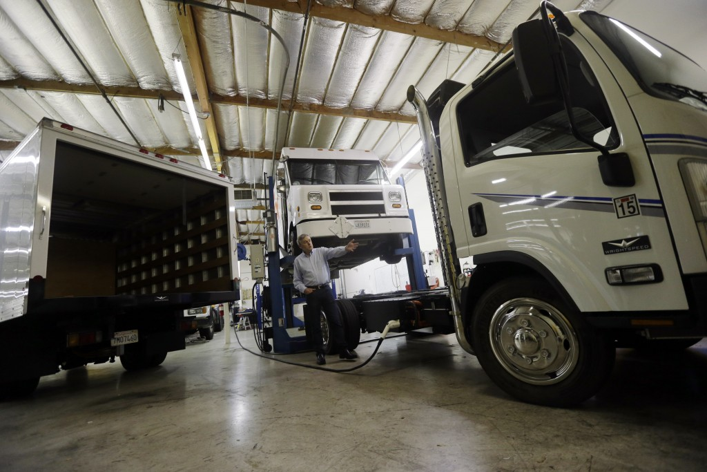 Wrightspeed CEO Ian Wright displays some of the company's electric-powered trucks on Thursday, Feb. 12, 2015 in San Jose , Calif. (AP Photo/Marcio Jose Sanchez)