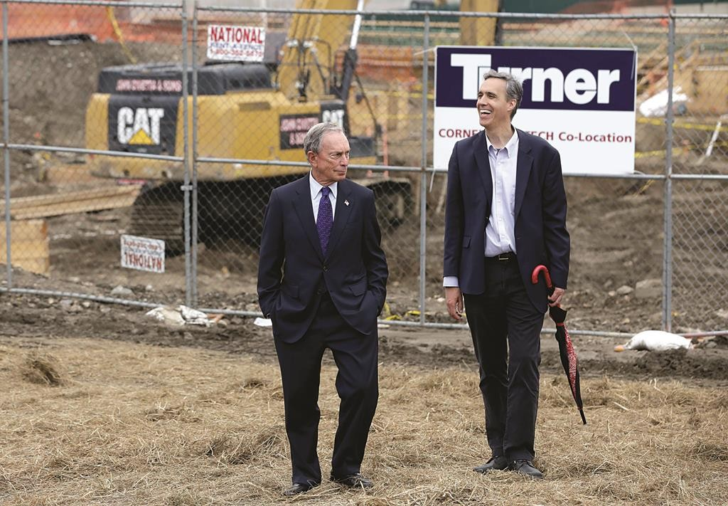 Former Mayor Michael Bloomberg (L) and Cornell Tech Dean Dan Huttenlocher on Tuesday stand at the construction site of the Cornell Tech campus on Roosevelt Island. (AP Photo/Seth Wenig)
