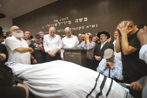 """Family and friends mourn at the levaya of Danny Gonen Hy""""d, who was murdered on Friday by a Palestinian gunman near Dolev, in Lod.  (Photo by FLASH90)"""