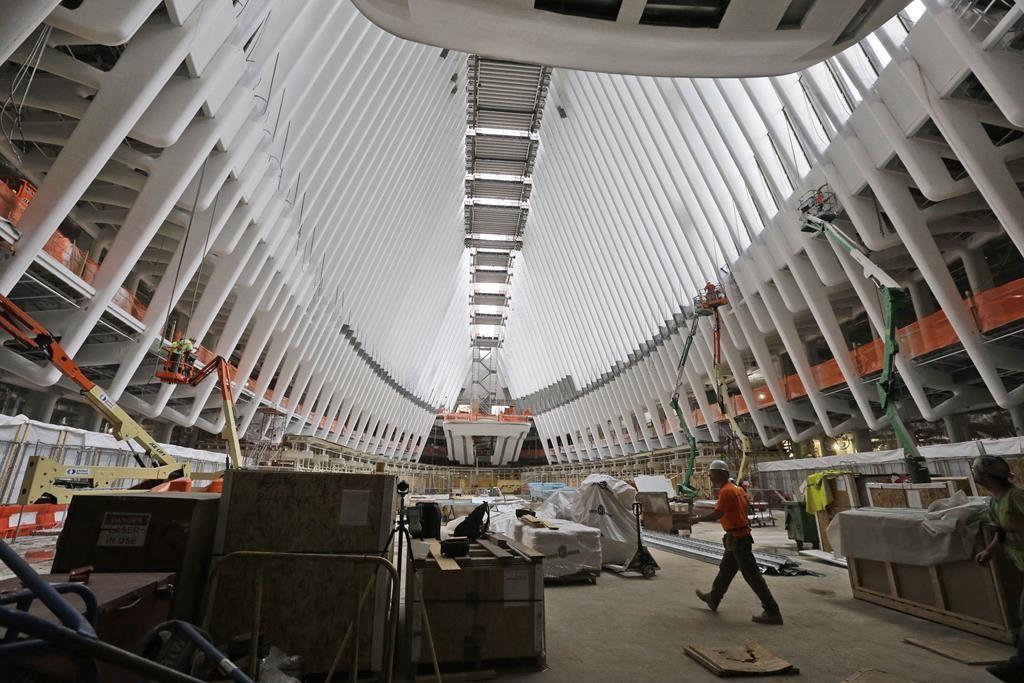Construction crews on Thursday work on the inside of the World Trade Center transportation hub. (AP Photo/Mary Altaffer)