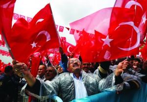 Supporters cheer Turkey's President Recep Tayyip Erdogan as he addresses an election rally in Ankara, Turkey, June 5, 2015.  (AP Photo/Burhan Ozbilici)