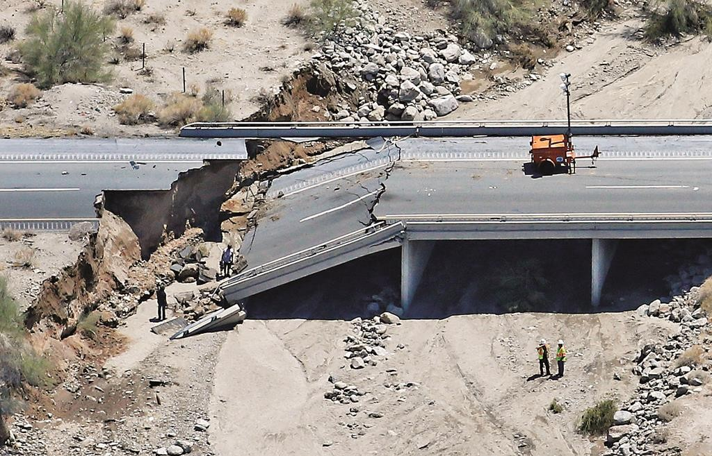 The collapsed elevated section of Interstate 10 in Desert Center, California, viewed from the air, on Monday.  (AP Photo/Matt York)