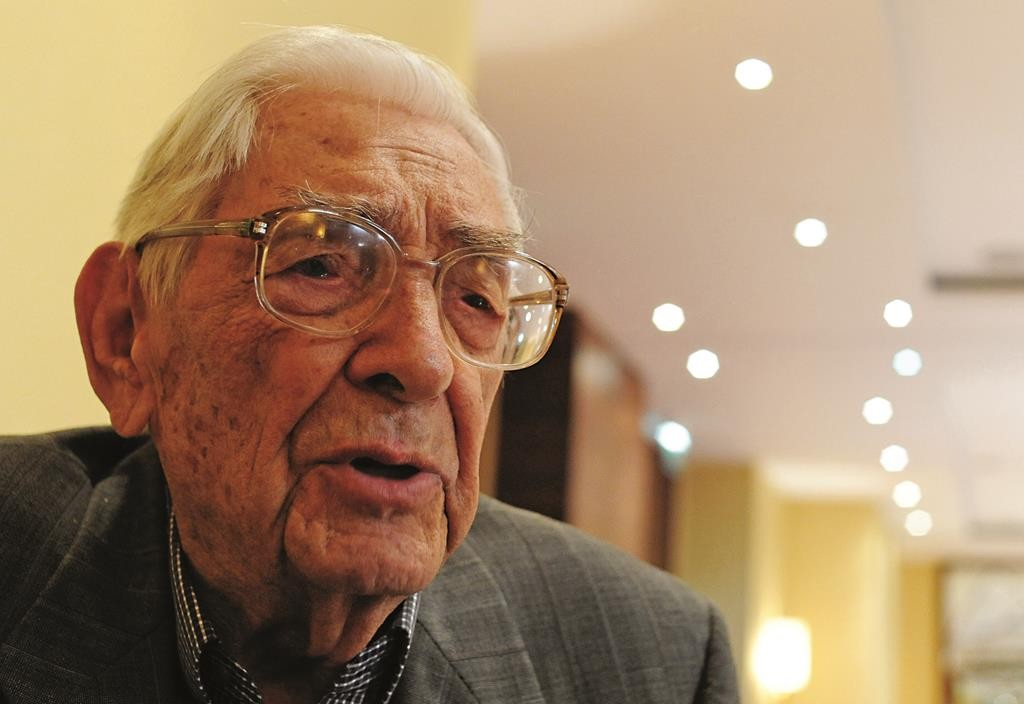 Rescuer Janusz Durko, 100 years old, speaks to The Associated Press at an event gathering nearly 50 elderly Christian Poles who saved Jews during World War II, in Warsaw, Poland, on Sunday. (AP Photo/Alik Keplicz)