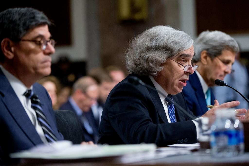 Secretary of Energy Ernest Moniz (C), accompanied by Secretary of State John Kerry (R) and Secretary of Treasury Jack Lew (L), testifies at a Senate Foreign Relations Committee hearing on Capitol Hill, in Washington, Thursday, to review the Iran nuclear agreement. (AP Photo/Andrew Harnik)