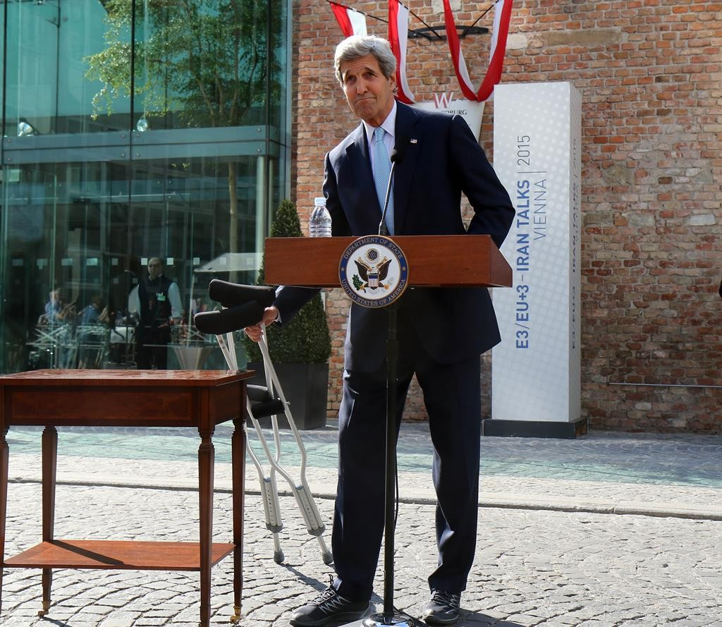 Secretary of State John Kerry speaks to the media in front of Palais Coburg where closed-door nuclear talks with Iran took place in Vienna, Austria, on Sunday. (AP Photo/Ronald Zak)