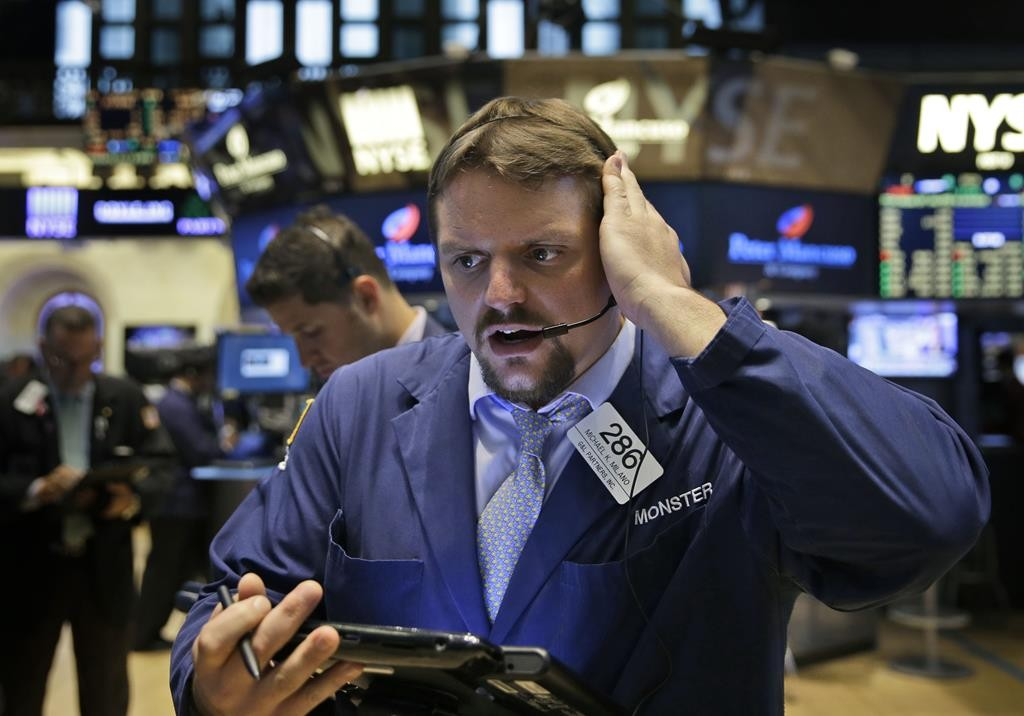 Traders work on the floor at the New York Stock Exchange in New York, Wednesday. (AP Photo/Seth Wenig)