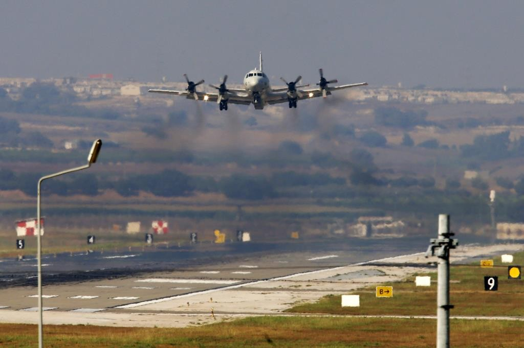 A United States Navy airplane about to land at the Incirlik Air Base, in the outskirts of the city of Adana, southern Turkey, Wednesday.  (AP Photo/Emrah Gurel)