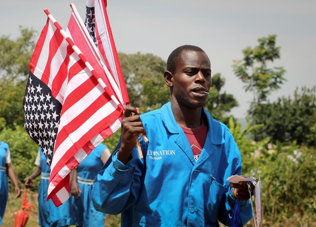 A vendor sells American flags at an event attended by Sarah Obama, the step-grandmother of President Barack Obama, in her home town of Kogelo, near Kisumu, in Kenya Saturday.  (AP Photo)