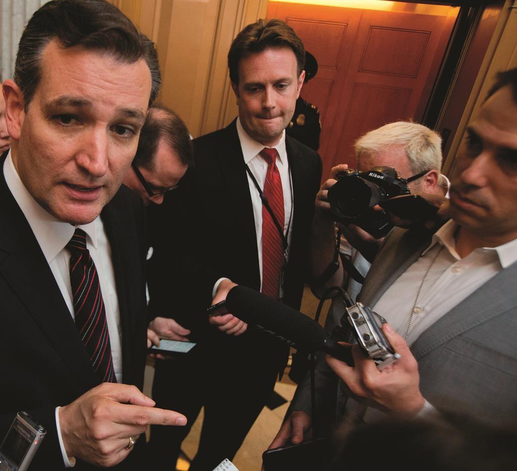 Sen. Ted Cruz, R-Texas, speaks to reporters following a rare Sunday Senate session on Capitol Hill in Washington, Sunday. (AP Photo/Manuel Balce Ceneta)