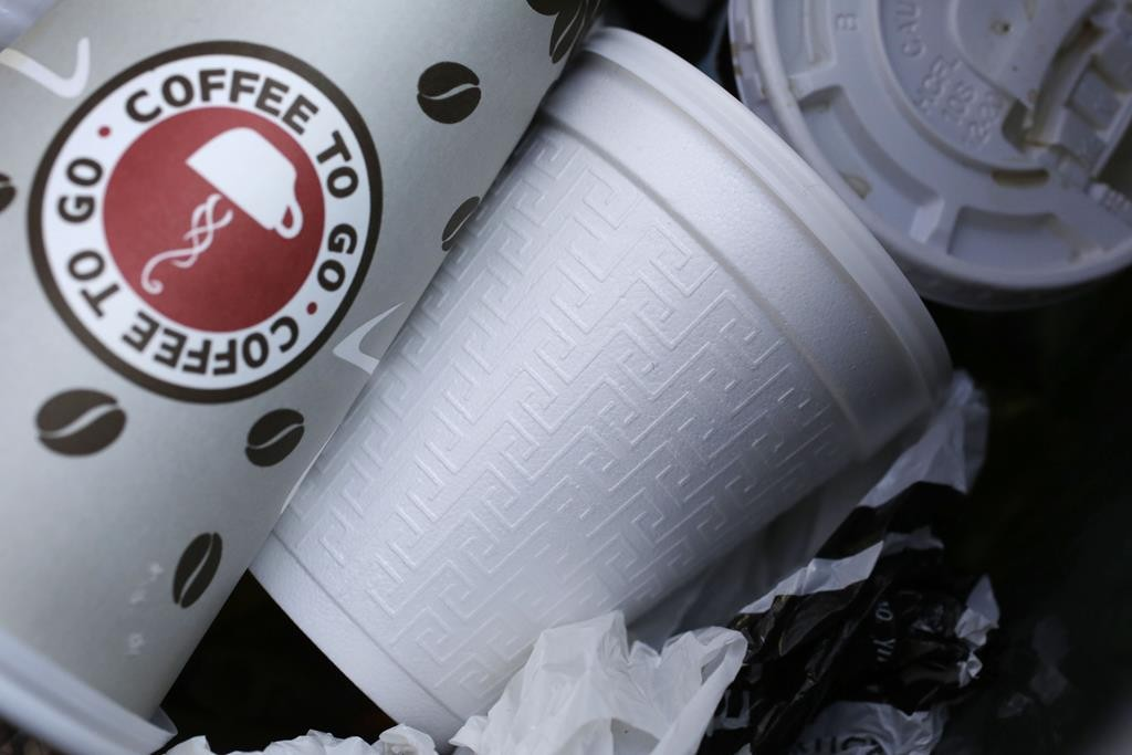 A foam cup, center, is discarded in a trash bin in New York.  (AP Photo/Mark Lennihan, File)