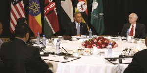 U.S. President Barack Obama holds a meeting on South Sudan and counterterrorism issues with African heads of state at his hotel in Addis Ababa, Ethiopia Monday. Pictured at the table are: U.S. Special Envoy to Sudan and South Sudan Donald Booth (R), Sudan's Minister of Foreign Affairs Ibrahim Ghandour (2nd L, back to camera) and Kenya's President Uhuru Kenyatta (L). (REUTERS/Jonathan Ernst)