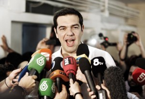 Greek Prime Minister Alexis Tsipras speaks to the press after placing his vote in the austerity referendum at a local school in the suburbs of Athens on Sunday in Athens, Greece.  (Milos Bicanski/Getty Images)