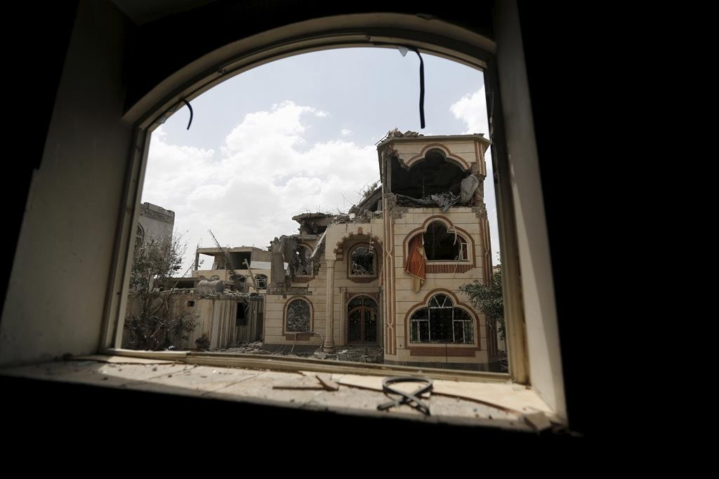 The house of Brigadier Khaled al-Anduli, an army commander loyal to the Houthi movement, after it was hit by Saudi-led air strikes in Yemen's capital, Sanaa, Tuesday. (REUTERS/Khaled Abdullah)