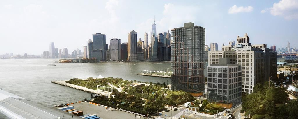 Two proposed apartment buildings, right front, next to Pier 6, center, on the Brooklyn waterfront bordering the East River. (ODA/RAL Development Services/Oliver's Realty Group via AP)