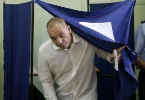 Greece's Finance Minister Yanis Varoufakis casts his vote at a polling station in Athens, on Sunday. (AP Photo/Petr David Josek)