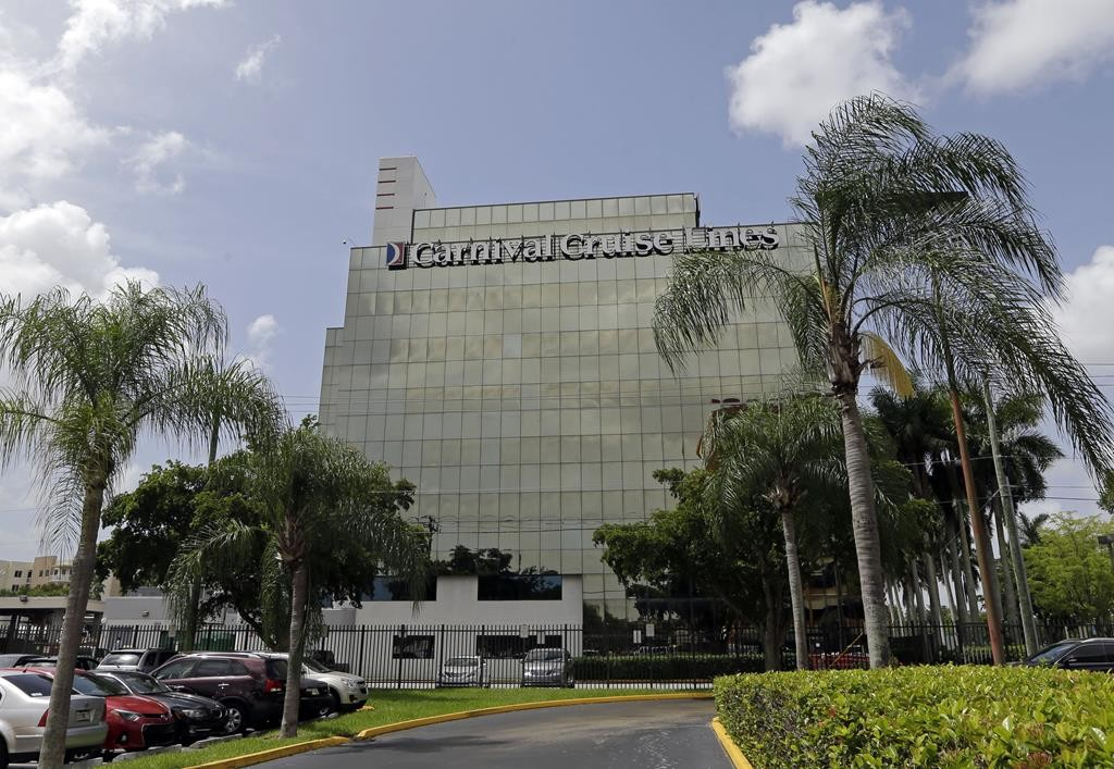 Carnival Cruise Lines' main office building in Miami. Starting in May, Carnival Corp. plans to offer trips from Miami to Cuba, the company announced Tuesday. It says it would become the first American cruise company to visit the Caribbean island nation since the 1960 trade embargo.  (AP Photo/Alan Diaz)