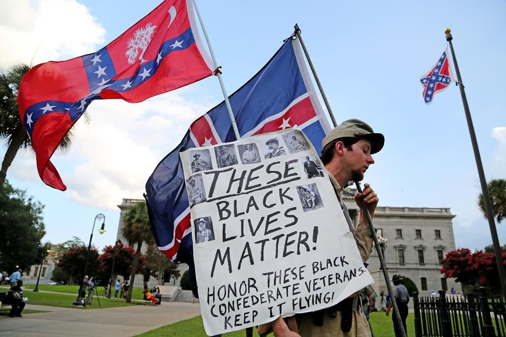 Josh Clarke, of Shelby, N.C., voices his side of the Confederate flag issue in front of the Statehouse, Monday, in Columbia, S.C. (Gerry Melendez/The State via AP)
