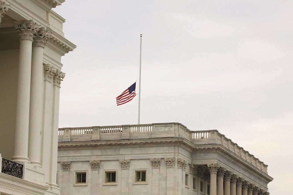 The flag is seen at half-staff at the U.S. Capitol on Tuesday, in Washington, D.C. The flags at the U.S. Capitol and at the White House were lowered to half-staff on Tuesday to honor the five service members killed in Chattanooga, Tennessee, last week. (AP Photo/Lauren Victoria Burke)