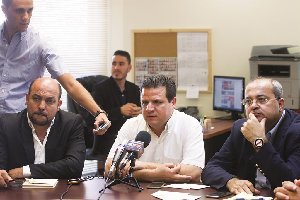 Leader of the Joint Arab list Ayman Odeh (C) with MK Masud Gnaim (L) and MK Ahmad Tibi at the party's weekly meeting in the Knesset. (Miriam Alster/Flash90)