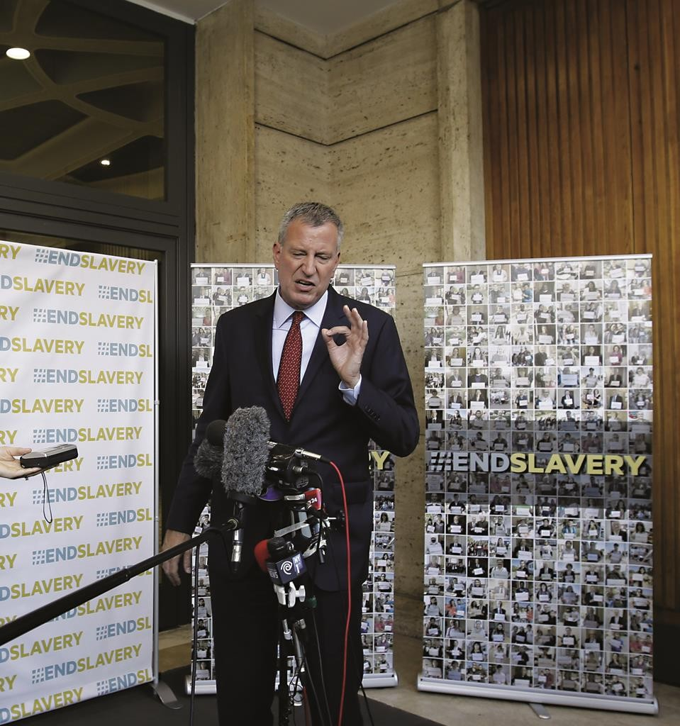 Mayor Bill de Blasio holds a press conference Tuesday after participating in a conference on Modern Slavery and Climate Change at the Vatican. (AP Photo/Gregorio Borgia)