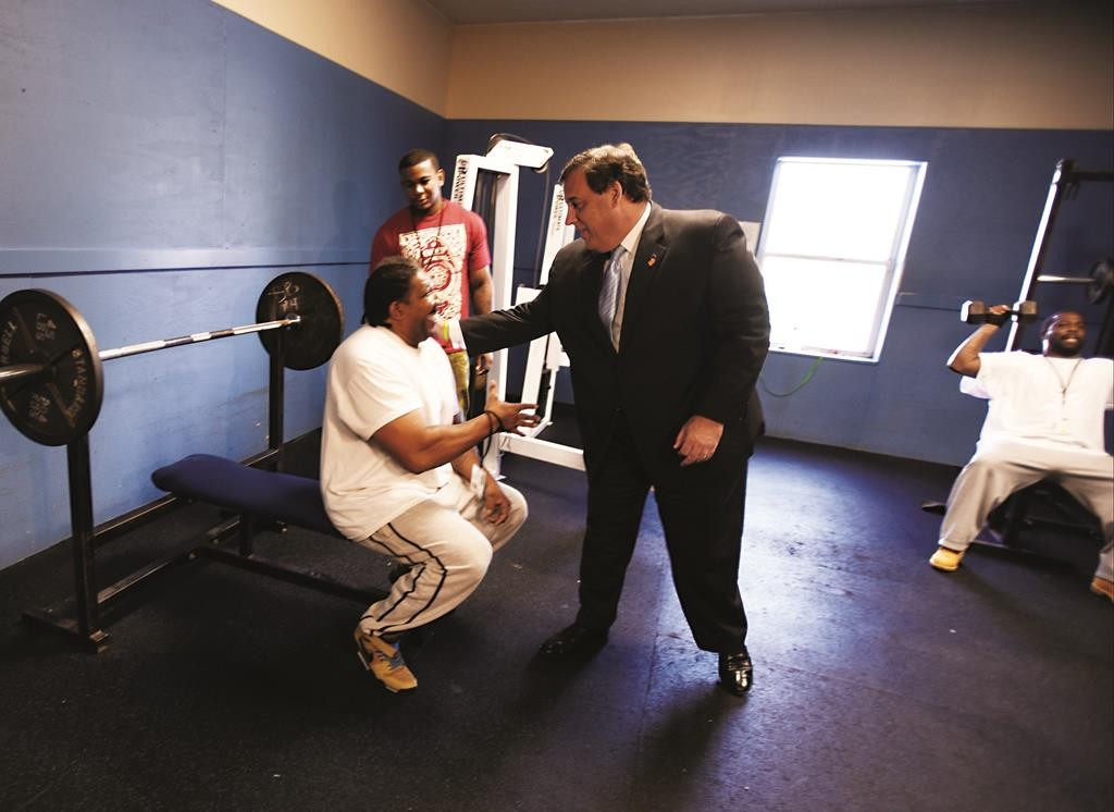 New Jersey Gov. Chris Christie on Thursday meets with Hope Hall clients in Camden, N.J., where he gave a speech calling for changes in the criminal justice system. (Chris Pedota/NJ.com via AP)