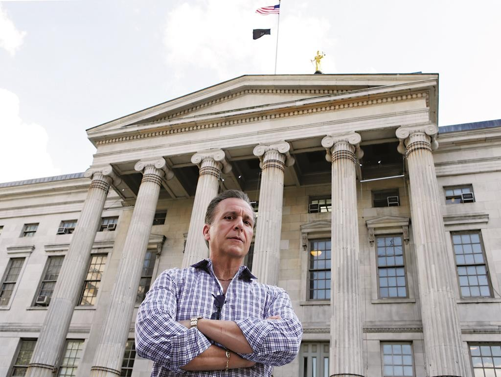 Joe Ponzi, former chief of the Brooklyn District Attorney Investigators, poses in front of Brooklyn's Borough Hall. (AP Photo/Kathy Willens)