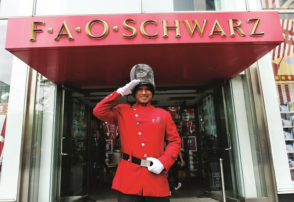 Saluting 150 Years of Fun: An FAO Schwartz employee outside the Fifth Avenue store. (Timothy A. Clary/AFP/Getty Images)