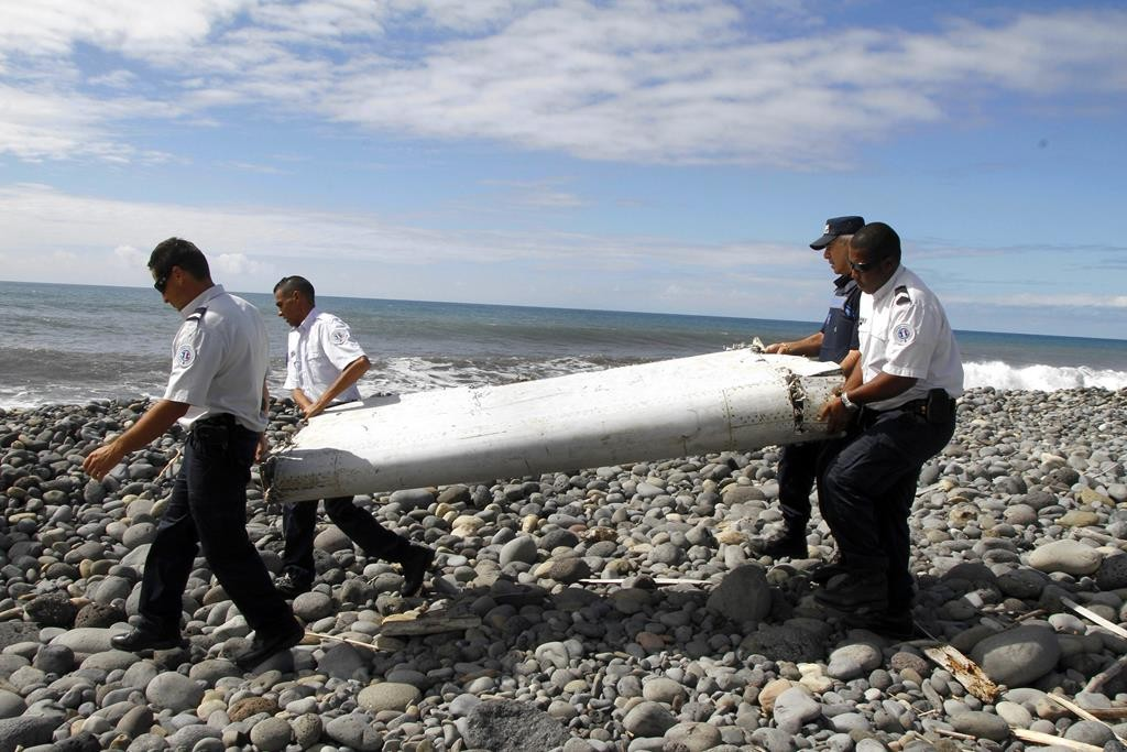 Plane debris found on the Indian Ocean island of Reunion, seen here on Thursday, will be transported to France to find out whether it is from missing airliner MH370, Malaysia's prime minister has said.  (Raymond Wae Tion/Maxppp/Zuma Press/TNS)
