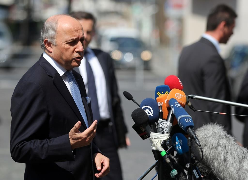French Foreign Minister Laurent Fabius talks to media at the Palais Coburg, where closed-door nuclear talks with Iran are taking place, in Vienna, Austria, Tuesday. (AP Photo/Ronald Zak)