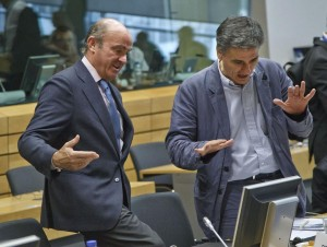 Greek Finance Minister Euclid Tsakalotos, right, speaks with Spanish Economy Minister Luis de Guindos during a meeting of eurozone finance ministers at the EU LEX building in Brussels on Tuesday. (AP Photo/Michel Euler)