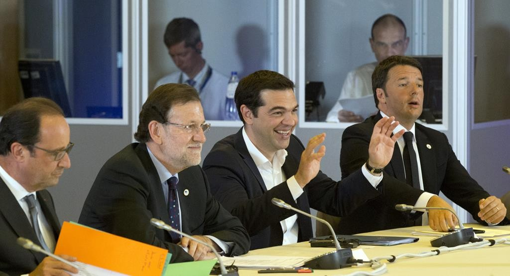 Greek Prime Minister Alexis Tsipras, second right, gestures while speaking during a meeting at an emergency summit of eurozone heads of state or government at the EU Council building in Brussels on Tuesday. From left, French President Francois Hollande, Spanish Prime Minister Mariano Rajoy and Italian Prime Minister Matteo Renzi.  (AP Photo/Michel Euler)