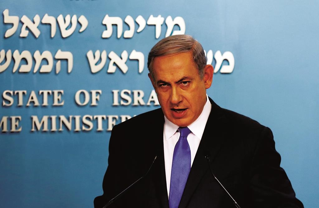 Israel's Prime Minister Binyamin Netanyahu speaks at a news conference in Yerushalayim Tuesday. (REUTERS/Ammar Awad)