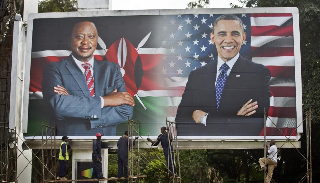 Workers finish installing a large billboard showing Kenya's president, Uhuru Kenyatta and U.S. President Barack Obama in downtown Nairobi, Kenya, on Thursday. (AP Photo/Ben Curtis)