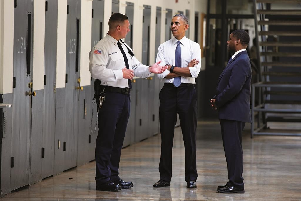 President Barack Obama is led on a tour by Bureau of Prisons Director Charles Samuels, right, and correctional officer Ronald Warlick during a visit to the El Reno Federal Correctional Institution in El Reno, Okla.,Thursday. (AP Photo/Evan Vucci)