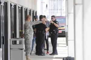 Chattanooga police talk to Reserve Recruitment Center personnel at the Lee Highway office in Chattanooga, Tennessee after the shooting attack, Thursday.  (Tim Barber/Chattanooga Times Free Press via AP)
