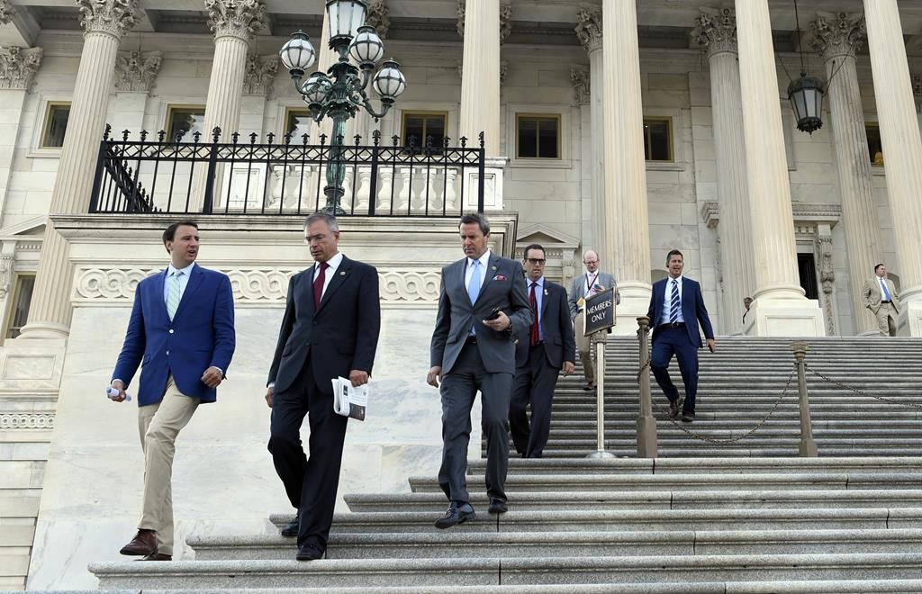 Members of the House of Representatives walk down the steps on Capitol Hill in Washington, after their final vote before their summer recess. (AP Photo/Susan Walsh)