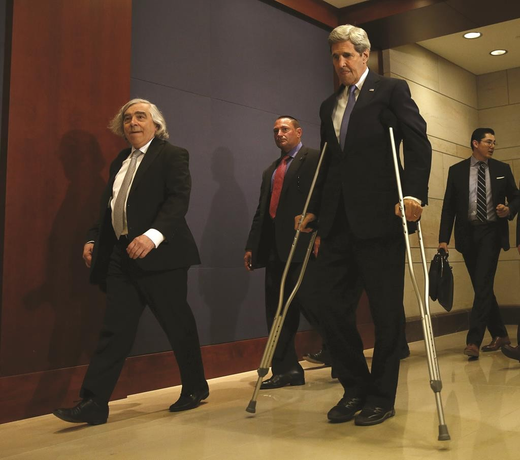 Secretary of State John Kerry (R) and Energy Secretary Ernest Moniz (L) walk to a closed-door briefing with House members on the recent Iran nuclear deal in Washington, Wednesday . (REUTERS/Gary Cameron)