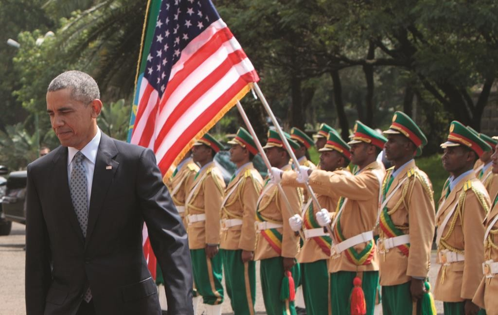 President Barack Obama is greeted by an honor guard as he arrives to meet with Ethiopian prime minister, Hailemariam Desalegn at the National Palace in Addis Ababa, Ethiopia, Monday. (AP Photo/Sayyid Azim)
