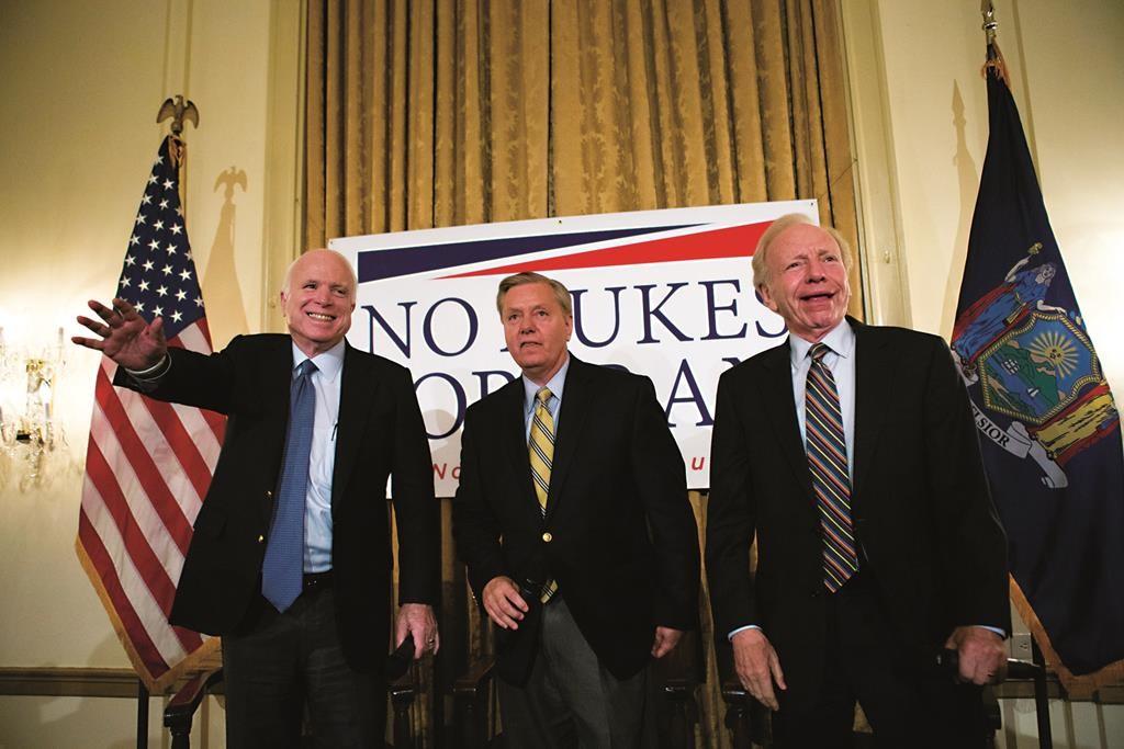 L-R: Senator John McCain (R-AZ), Republican presidential candidate Senator Lindsey Graham (R-SC), and former Senator Joe Lieberman attend a campaign event in New York on Monday. (REUTERS/Brendan McDermid)