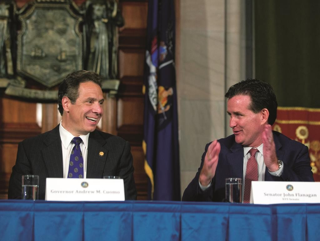 Senate Majority Leader John Flanagan (R) speaks to Gov. Andrew Cuomo during a news conference in June in the Red Room at the Capitol, Albany, New York. (AP Photo/Mike Groll)